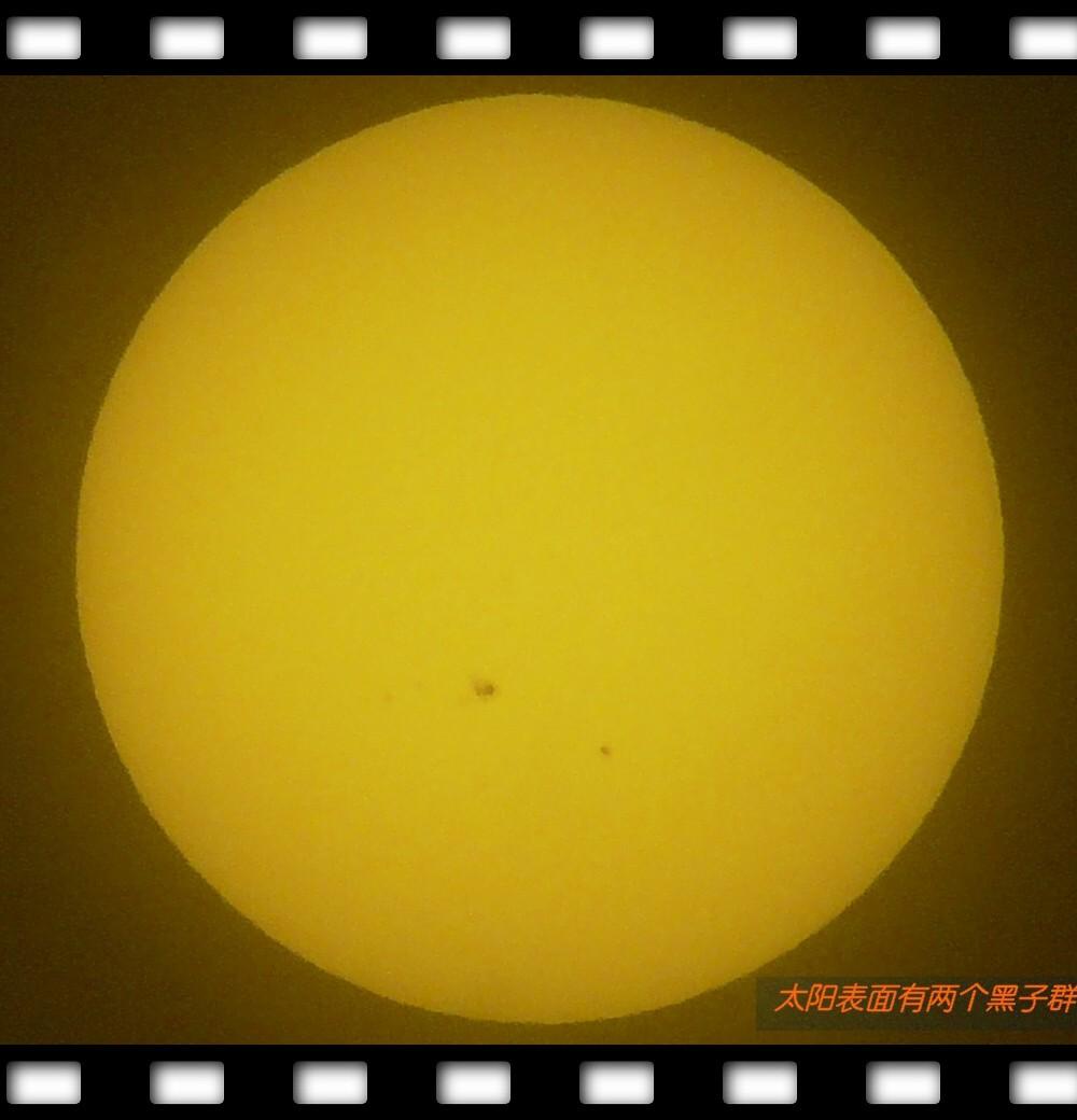 2、太阳表面一大一小两个黑子群